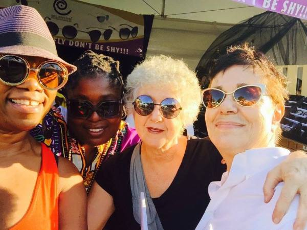Shopping for sunglasses at Afropunk. Deb Mitchell, Diamond (Exclusives Eyewear), Marian Rivman, Ruth LaFerla.