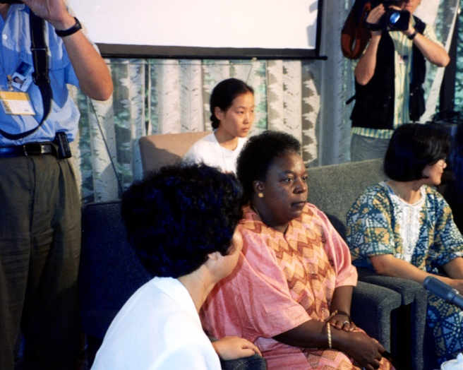 Beijing 1995 - Center: Gertrude Mongella, Secretary General of the Fourth World Conference on Women, at a press conference in Huairao